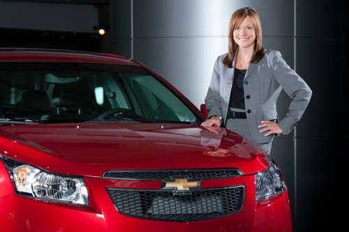 GM CEO Mary Barra poses with a Chevy